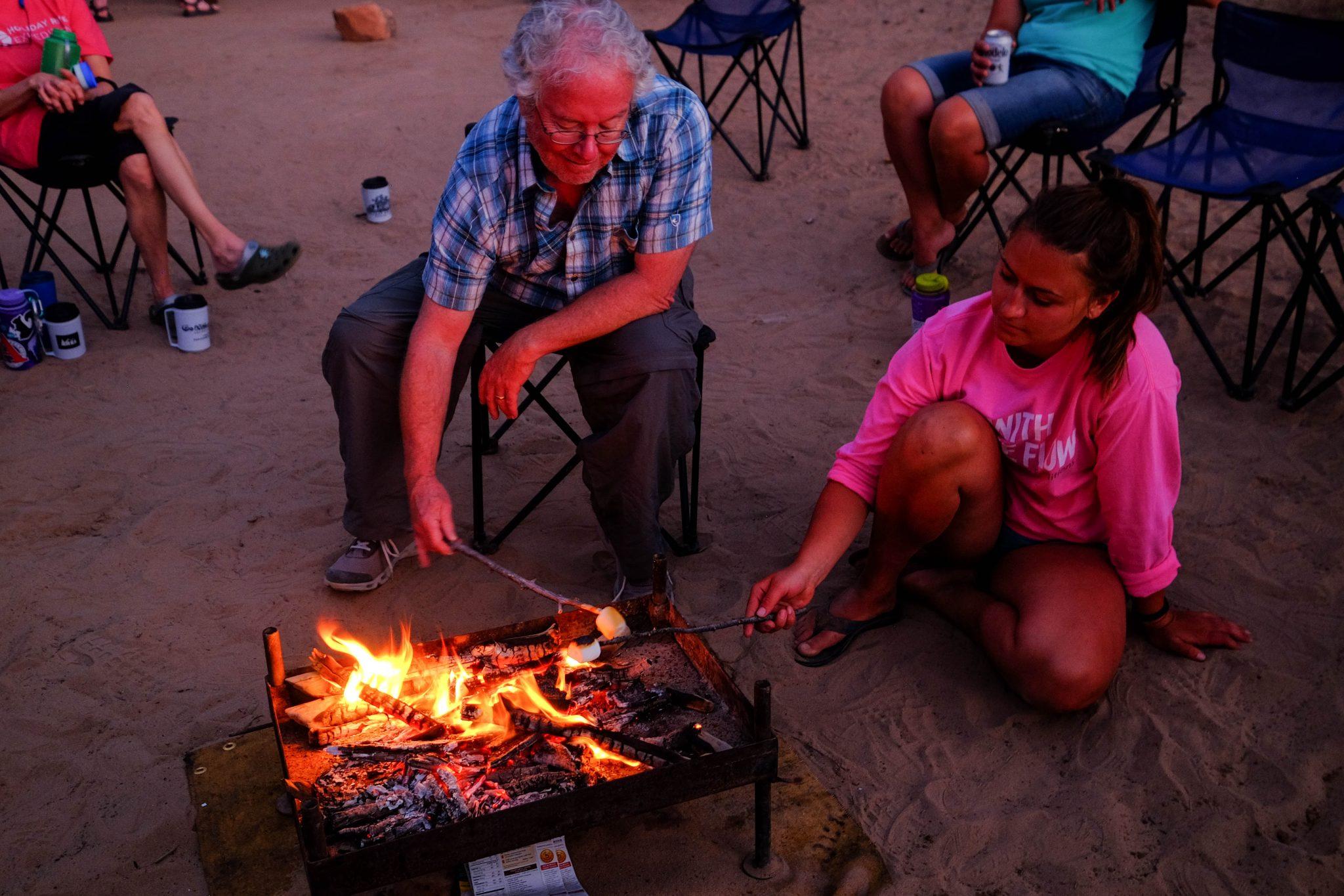 Roasting Marshmallows around campfire