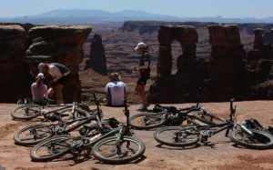Francisco Kjolseth | The Salt Lake Tribune Riders on the White Rim Trail in Canyonlands National Park take a water break and take in some of the amazing scenery of the area. Mountain biking the White Rim trail in Canyonlands in May of 2013