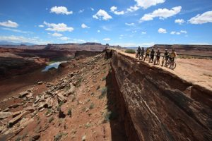 Francisco Kjolseth | The Salt Lake Tribune Mountain bikers on a Holiday Expeditions mountain bike tour take in the scene at the Colorado River overlook during a White Rim Trail trip in Canyonlands Natioanl Park in May, 2013.