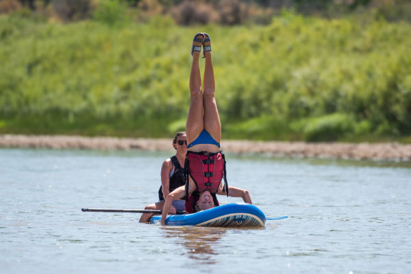 Playing on a Stand-up Paddleboard on the Colorado River