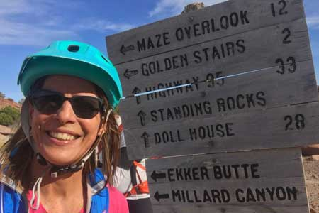 Martha Macomber biking the Maze